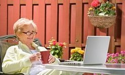 Senior adult woman working on computer