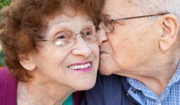 Senior Man Kissing Senior Woman