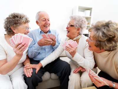 Group of happy people enjoying a card game